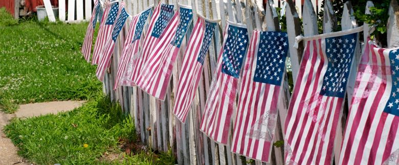 American Flags on a Fence